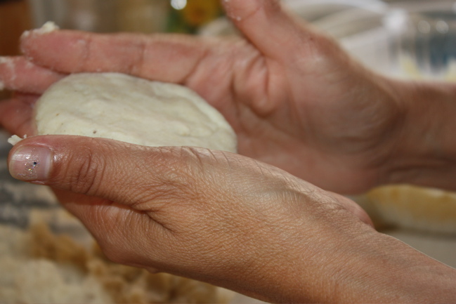 2. Shape the masa down into a fat disc about 2 inches in diameter.